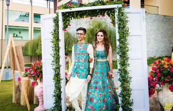 Matching bride and groom wearing same fabric on mehendi