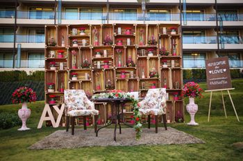 Rustic mehendi decor with bride and groom seat photobooth