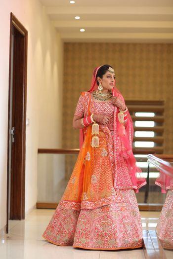 Orange and pink bridal lehenga with net dupatta