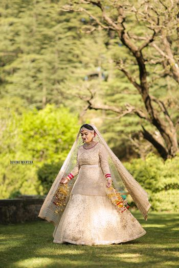 Photo of Gold lehenga with long blouse