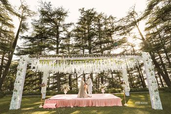 Photo of Forest wedding setting with open pastel mandap