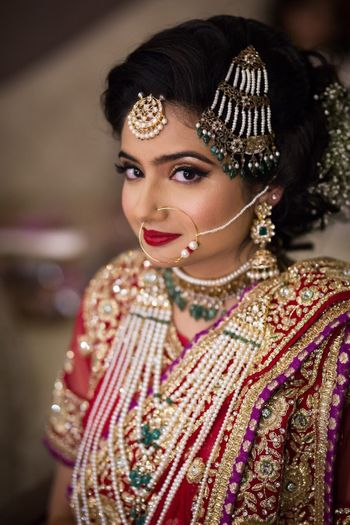 Bride wearing pearl and green bead jewellery