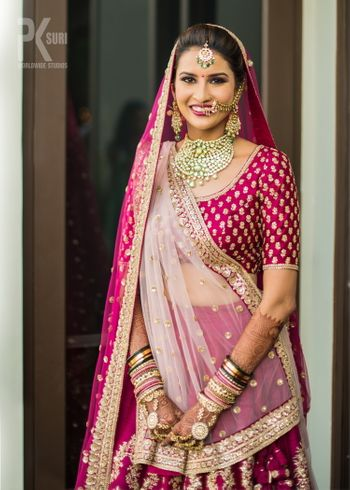 Photo of Bride in maroon with double dupatta