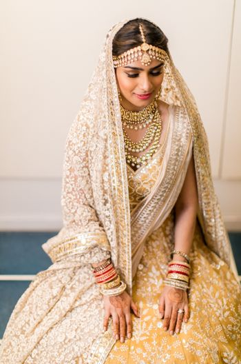 Photo of Bride in yellow lehenga