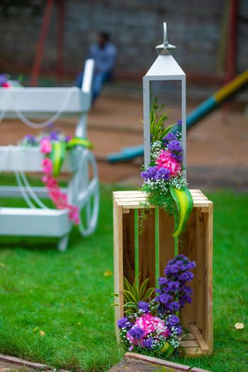 Photo of Decor with wooden crates and florals