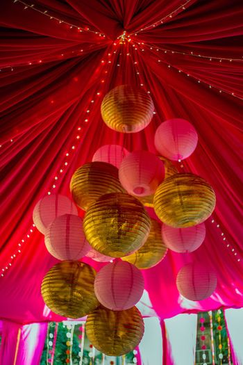 Photo of gold and pink paper lanterns