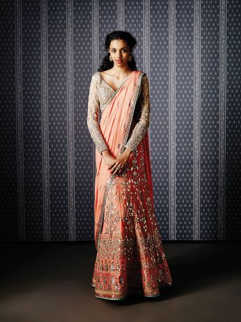 Photo of peach and grey lehenga sari