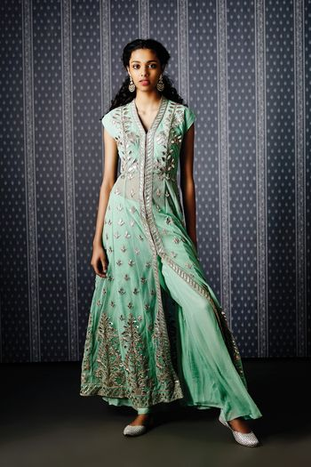Photo of mint green pallazo pants and sheer floor length kurta