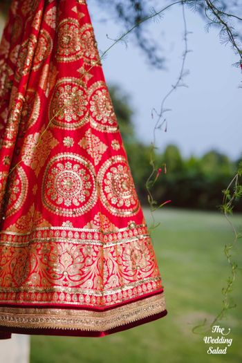 Red benarasi lehenga on hanger