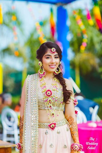 Bridal mehendi jewellery with floral satlada