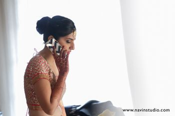 Photo of bride talking on the phone