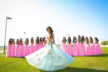 Matching bridesmaids and twirling bride