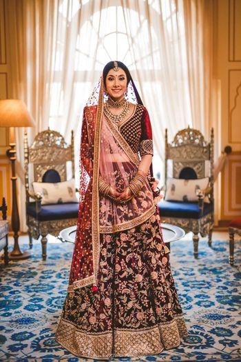 Bride in maroon floral print velvet lehenga