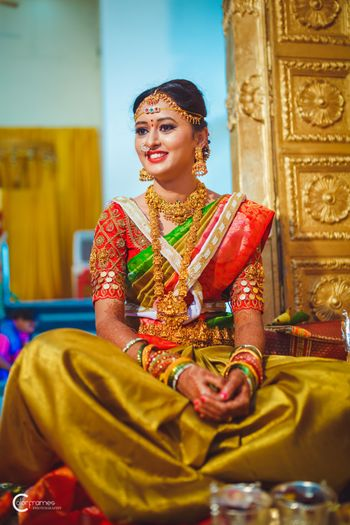 A south Indian bride poses in a kanjeevaram and temple jewellery