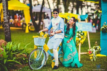 Photo of Couple on a Bicycle Mehendi Shot