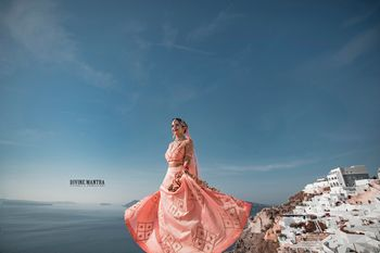 Twirling bride in peach lehenga Santorini