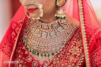 Elaborate bridal necklace with red lehenga