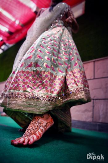 Bird motif lehenga and bridal feet mehendi