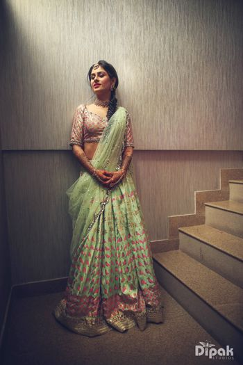 Light green mehendi lehenga with motifs