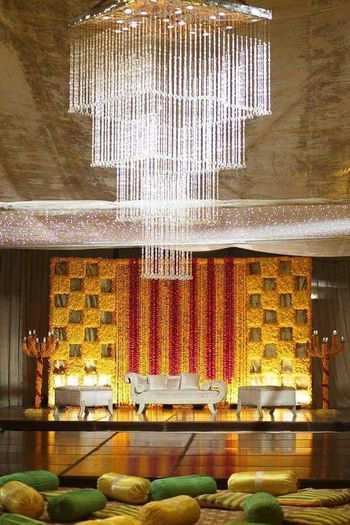 Stunning floral yellow and orange south Indian decor for wedding