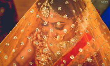 bride in veil shot