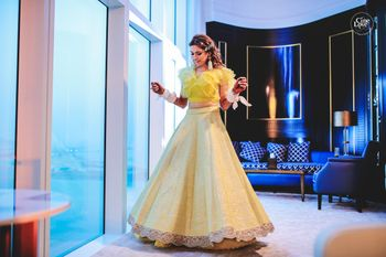 Modern mehendi lehenga with ruffled blouse