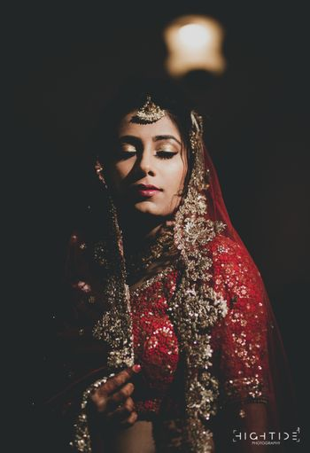Subtle bridal makeup gold eye with red lehenga