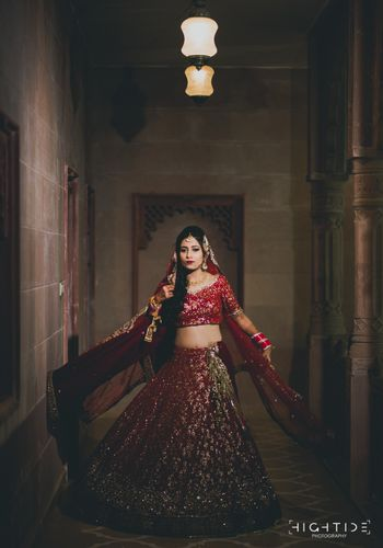 Bridal portrait with maroon sequin work lehenga