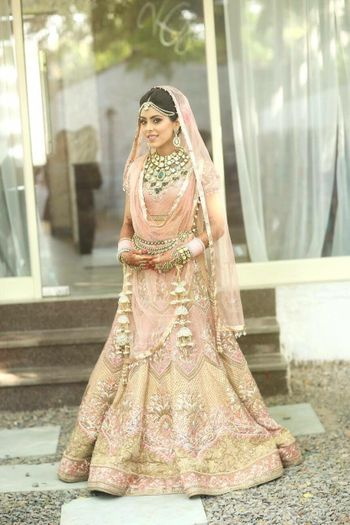 Pastel Peach Lehenga with Gold Work and Emerald Jewelry