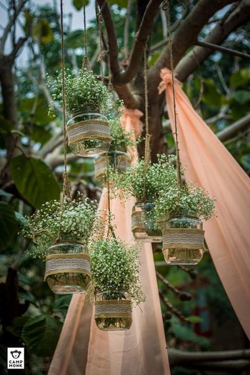 Rustic decor with hanging mason jars and babys breath