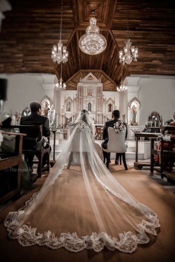 Christian wedding gown with a huge train