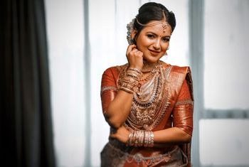 Stunning south indian bride wearing temple jewellery for her wedding