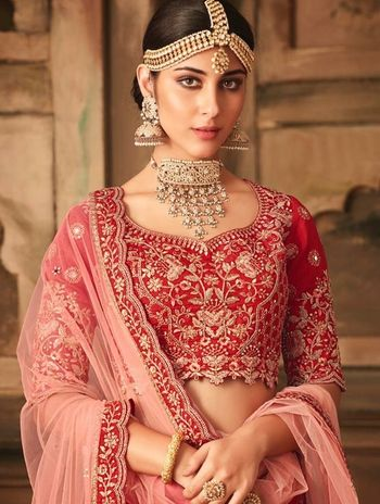 Pretty red bridal lehenga with unique choker necklace
