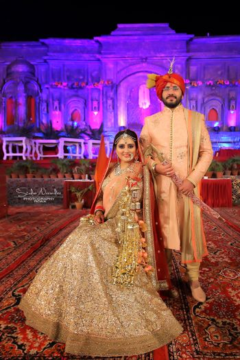 coordinated bride and groom outfits