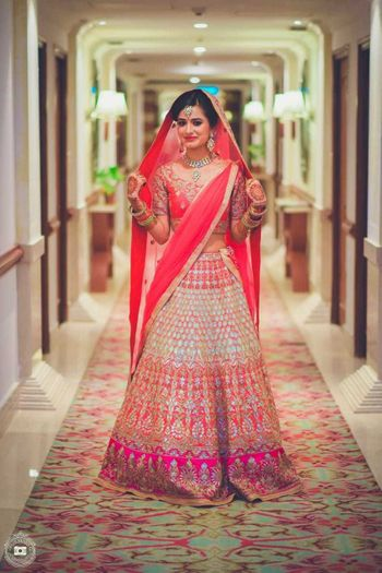 Stunning bride wearing ombre lehenga for the wedding
