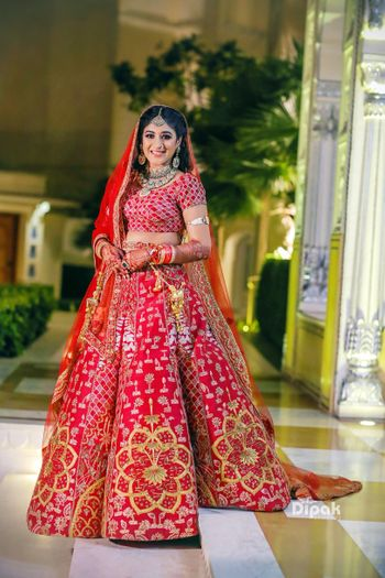 Red modern bridal lehenga with floral motifs