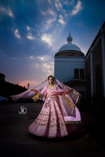 Pretty pink bridal lehenga with golden kaleere for wedding