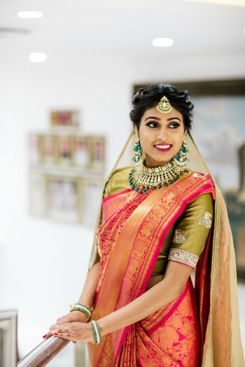 Bride in orange kanjivaram and dupatta
