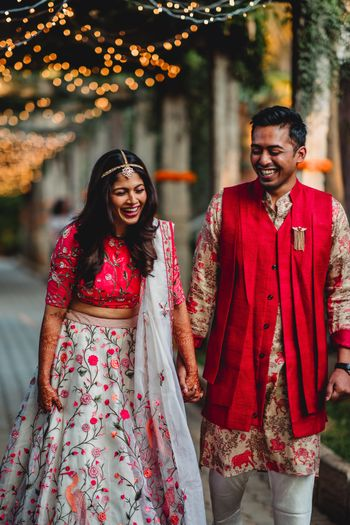 Matching bride and groom in red on mehendi