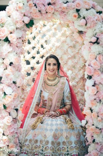 Bride in floral Palki shot