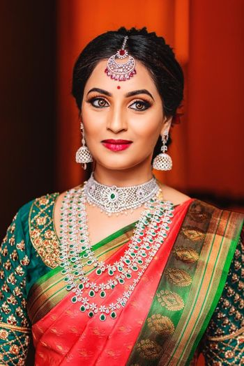 Photo of A bride wearing exquisite silver jewelery