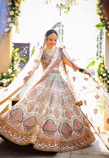 Photo of Offbeat white and blue bridal lehenga
