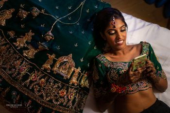 Bride on bed with lehenga getting ready shot idea