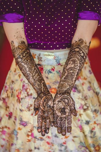 Unique bridal half and half mehendi design with Pooja