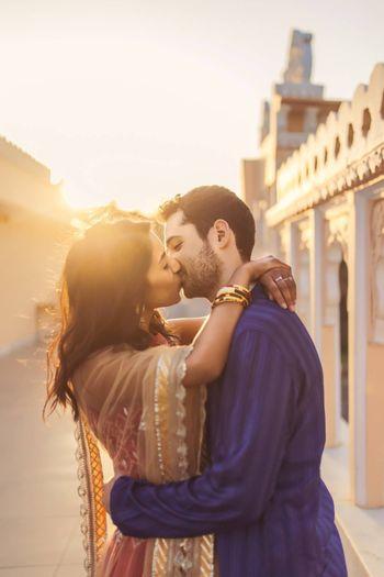 Couple kissing pre wedding shot