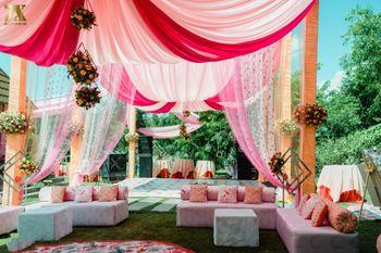 Mehendi decor idea with draped tents