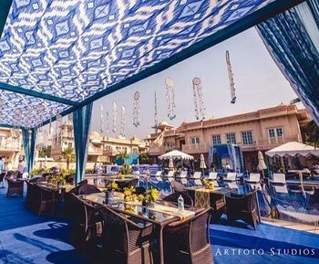 Photo of Blue mehendi theme with ikat print tent