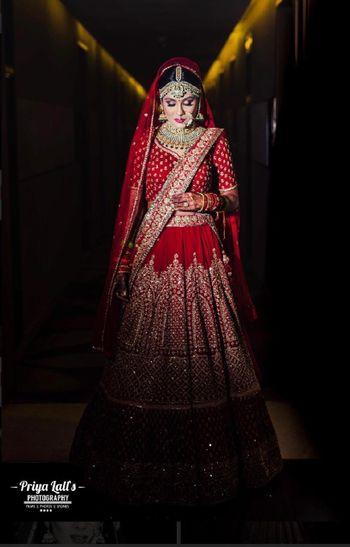 Shadow bridal portrait in red lehenga