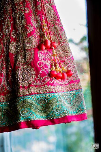 pink and turquoise bridal lehenga