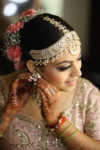 Photo of Bride getting ready shot wearing mathapatti